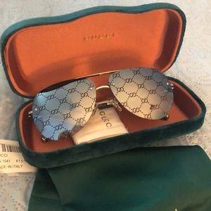 Gucci monogram lenses sunglasses